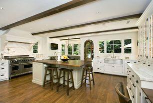 """Traditional Kitchen with Breakfast bar, Viking - 48"""" gas range - vgcc, Kohler hi-rise pot filler, Pendant light, Glass panel"""