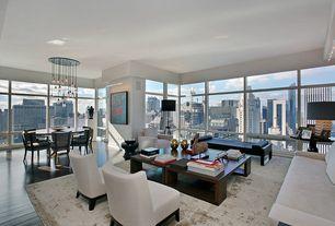 Contemporary Great Room with Standard height, Hardwood floors, picture window, Chandelier, specialty window