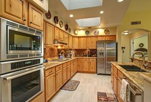 Country Kitchen with can lights, Wall Hood, Arizona tile - eramosa sand porcelain, wall oven, Multiple Sinks, Slate Tile