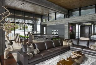 Contemporary Living Room with Large picture windows, Kitchen island, Exposed beam, Chandelier, Bellawood select maple