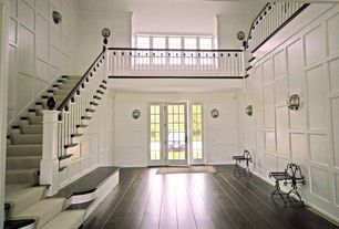 Traditional Entryway with French doors, Hardwood floors, Wall sconce, Balcony, High ceiling