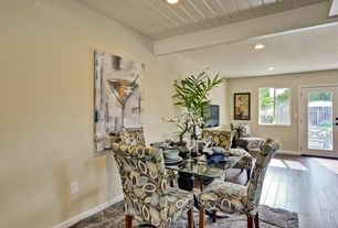 Contemporary Dining Room with Hardwood floors, Standard height, Exposed beam, can lights, picture window, French doors