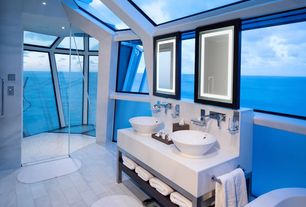 Modern Master Bathroom with Standard height, Skylight, Shower, stone tile floors, Quartz counters, can lights, Vessel sink