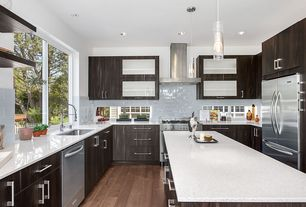 Contemporary Kitchen with Flush, Glass tube pendant light, Hardwood floors, Subway Tile, Undermount sink, Glass panel