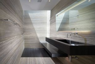 Contemporary Master Bathroom with Skylight, travertine floors, Kohler Falling Water Wall Mount Bathroom Sink Faucet