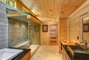 Rustic Master Bathroom with Simple granite counters, Handheld showerhead, Master bathroom, frameless showerdoor, High ceiling