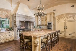 Traditional Kitchen with Complex granite counters, High ceiling, House of antique hardware, Breakfast bar, Classic chandelier