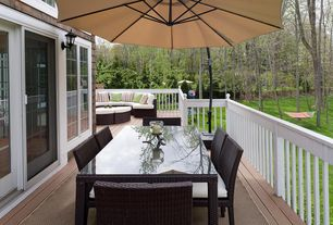 Traditional Deck with Hampton Wicker Forever 7-Piece Patio Dining Set, Pathway, Wood shingle, Ace Evert Offset Umbrella 10'