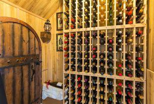 Craftsman Wine Cellar with Built-in bookshelf, Standard height, Exposed beam, Hardwood floors, specialty door