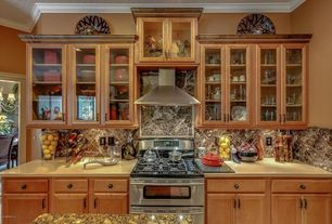 Craftsman Kitchen with full backsplash, can lights, Complex granite counters, Crown molding, Limestone counters, Wall Hood