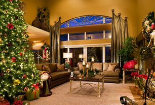 Mediterranean Living Room with can lights, High ceiling, Hardwood floors, Arched window, Drapery knob/finial, French doors