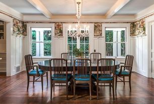 Traditional Dining Room with Chandelier, Crown molding, Exposed beam, interior wallpaper, Wainscotting, Hardwood floors