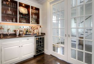 Traditional Bar with Built-in bookshelf, Crown molding, Standard height, can lights, French doors, Hardwood floors