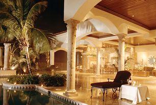 Mediterranean Porch with Wrap around porch, exterior stone floors, Raised beds