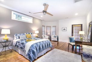 Traditional Master Bedroom with Ceiling fan, Laminate floors, Crown molding, Wainscotting