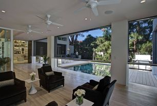 Contemporary room with Ceiling fan, Hardwood floors