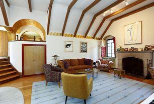 Eclectic Living Room with High ceiling, Hardwood floors, Built-in bookshelf, stone fireplace, Sunken living room