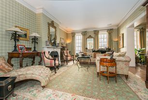 Traditional Living Room with Hardwood floors, Crown molding, Cement fireplace, Casement, Fireplace, Wall sconce
