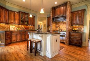 Country Kitchen with Custom hood, Complex granite counters, Crown molding, Kitchen island, Raised panel, flush light