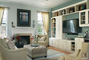 Traditional Living Room with Custom wood mantle, Remington upholstered rectangular nailhead ottoman, Wall mounted tv