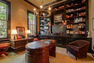 Traditional Home Office with Chandelier, interior wallpaper, Built-in bookshelf, Hardwood floors, Crown molding
