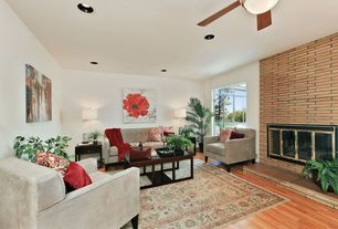 Contemporary Living Room with metal fireplace, Ceiling fan, Hardwood floors