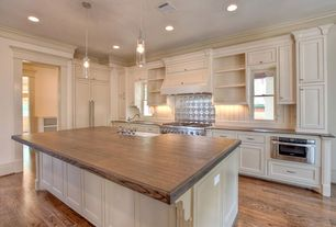Country Kitchen with gas range, Custom hood, Casement, Pendant light, Concrete counters, Standard height, One-wall, wall oven
