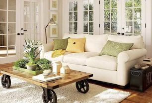 Country Living Room with Holly industrial cocktail cart table, Area rug, Hardwood floors, Buchanan roll arm upholstered sofa