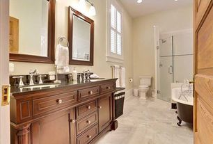 Traditional Master Bathroom with complex marble tile floors, Master bathroom, Clawfoot, Soapstone, Flat panel cabinets