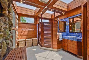 Rustic Master Bathroom with Poolhouse bathroom, Exposed rock wall, Bathroom floor tile, Wood paneled walls, Skylights