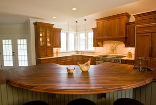 Country Kitchen with L-shaped, Glass panel, Crown molding, Custom hood, Built In Panel Ready Refrigerator, Wood counters