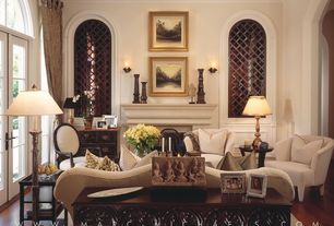 Traditional Living Room with Cement fireplace, Standard height, French doors, Arched window, Crown molding, Paint, can lights