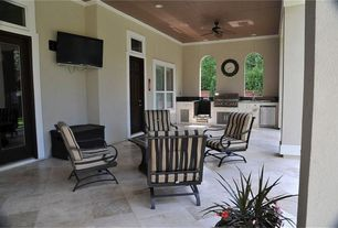 Mediterranean Porch with Transom window, exterior stone floors, Fence, Outdoor kitchen