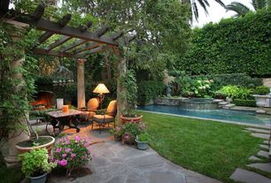 Traditional Landscape/Yard with exterior stone floors, Fence, Pier 1 rania table, Pool with hot tub, Pathway, Trellis