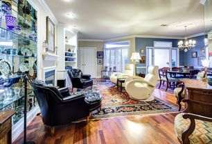 Eclectic Living Room with Standard height, Fireplace, Crown molding, Built-in bookshelf, can lights, Hardwood floors