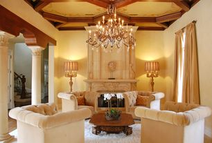 Mediterranean Living Room with Cement fireplace, Pillars, Oxford chair, Columns, Hardwood floors, Chandelier, High ceiling