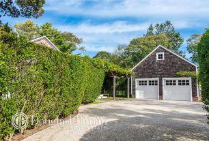 Traditional Garage with specialty door, Gravel driveway