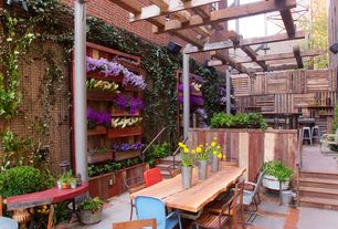 "Rustic Patio with Eden Brothers Grape Hyacinth Bulbs (Muscari) - ""White Magic"", Artemano 94"" Dining Table, Raised beds, Fence"