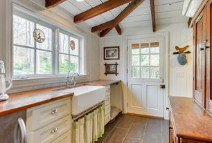 Country Kitchen with Galley, Daltile tuscan blue cs56 12x18 field tile, Exposed beam, Glass panel door, Dutch door