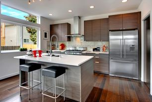 """Contemporary Kitchen with Long tab pull, Corian counters, White quartz countertop in """"snowstorm"""", Large Ceramic Tile, Flush"""