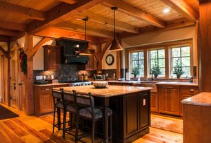 Country Kitchen with Copper cone pendant light, Farmhouse sink, Stone Tile, Inset cabinets, Custom hood, Pendant light