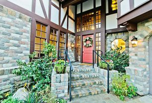 Traditional Front Door with Raised beds, Pathway, Transom window, exterior brick floors
