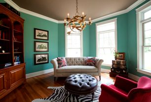 Traditional Living Room with Crown molding, Hardwood floors, Chandelier, Built-in bookshelf