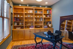 Traditional Home Office with double-hung window, Hardwood floors, Built-in bookshelf, Standard height, can lights