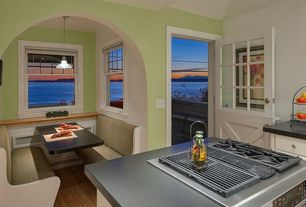 Country Dining Room with Pendant light, Hardwood floors, Window seat