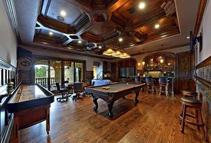 Traditional Game Room with Exposed beam, Crown molding, Pendant light, Hardwood floors, Wainscotting, specialty door, Balcony