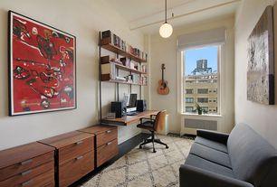Contemporary Home Office with Pendant light, Hardwood floors, Built-in bookshelf