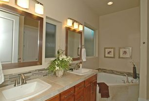Contemporary Master Bathroom with Standard height, travertine tile floors, Paint, Built-in bookshelf, can lights, Wall sconce