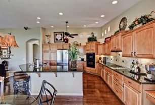 Traditional Kitchen with full backsplash, Breakfast nook, Standard height, double wall oven, Breakfast bar, Undermount sink