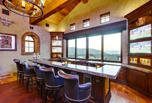 Bar with Hardwood floors, sandstone tile floors, Exposed beam, interior wallpaper, Arched window, Exposed beam ceiling